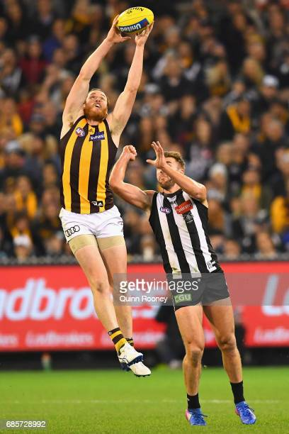 Jarryd Roughead of the Hawks marks infront of Lynden Dunn of the Magpies during the round nine AFL match between the Collingwood Magpies and the...