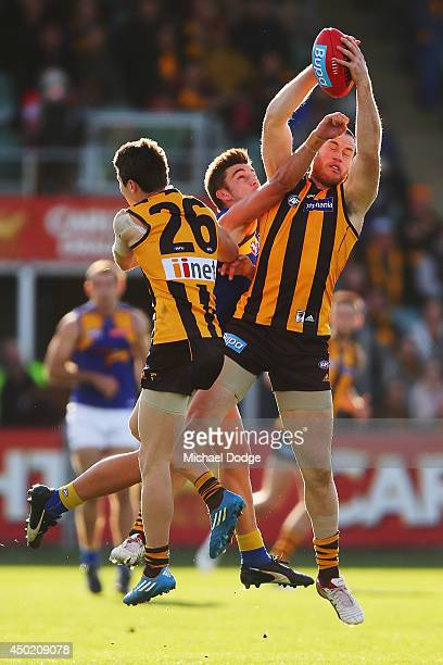 Jarryd Roughead of the Hawks marks the ball against Elliot Yeo of the Eagles during the round 12 AFL match between the Hawthorn Hawks and the West...