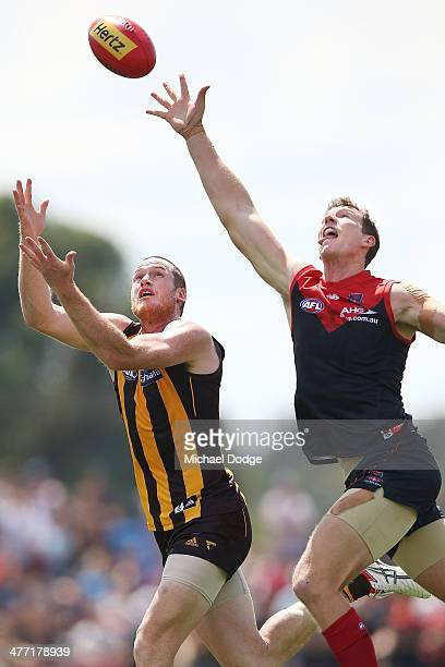 Jarryd Roughead of the Hawks marks the ball against Jake Spencer of the Demons during the AFL practice match between the Melbourne Demons and the...