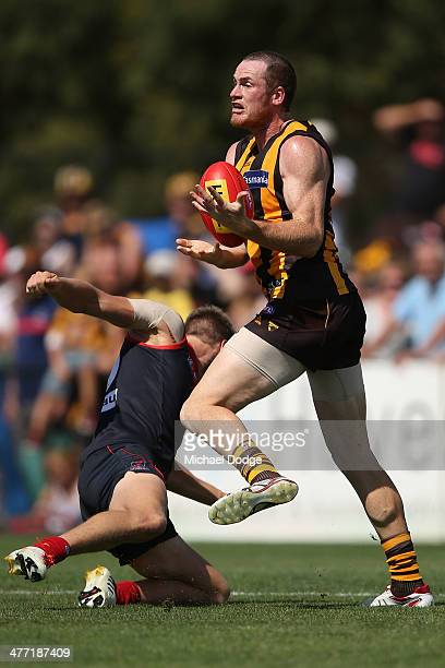 Jarryd Roughead of the Hawks rmarks the ball against Tom McDonald of the Demons during the AFL practice match between the Melbourne Demons and the...