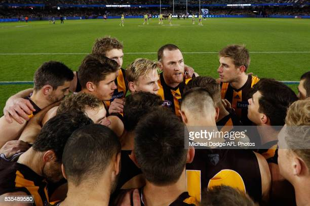 Jarryd Roughead of the Hawks speaks to teammates during the round 22 AFL match between the Carlton Blues and the Hawthorn Hawks at Etihad Stadium on...