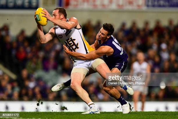 Jarryd Roughead of the Hawks stands up in a tackle from Ethan Hughes of the Dockers during the 2017 AFL round 18 match between the Fremantle Dockers...