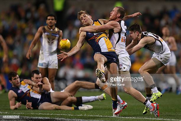 Jarryd Roughead of the Hawks tackles Brad Sheppard of the Eagles during the round 19 AFL match between the West Coast Eagles and the Hawthorn Hawks...