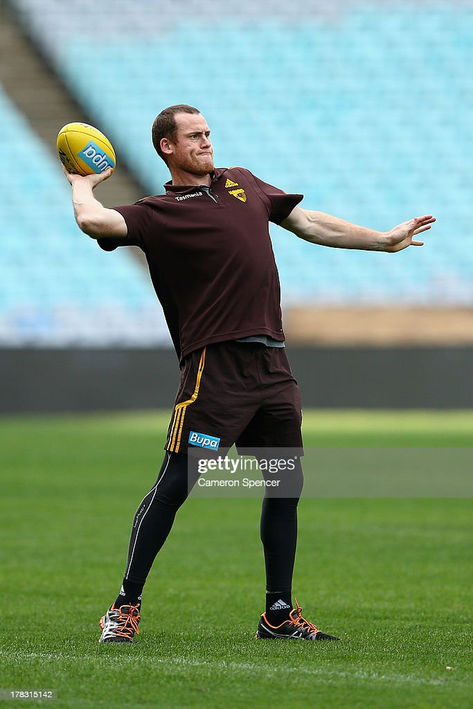 <a gi-track='captionPersonalityLinkClicked' href=/galleries/search?phrase=Jarryd+Roughead&family=editorial&specificpeople=227104 ng-click='$event.stopPropagation()'>Jarryd Roughead</a> of the Hawks throws the ball during a Hawthorn Hawks AFL training session at ANZ Stadium on August 29, 2013 in Sydney, Australia.