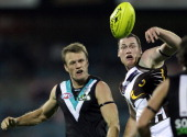Jarryd Roughead of the Hawks wins the ball over Dean Brogan of the Power during the round seven AFL match between Port Adelaide Power and the...