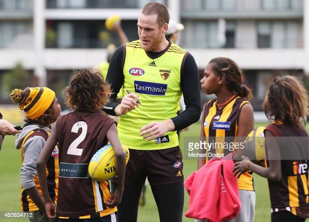 Jarryd Roughead playing his 200th game tomorrow signs autographs for fans during a Hawthorn Hawks AFL training session at Waverley Park on July 25...