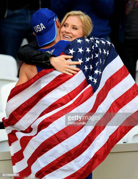 Jarryd Wallace of The USA celebrates with his partner after winning gold in the final of the mens 200m T44 on day nine of the IPC World ParaAthletics...