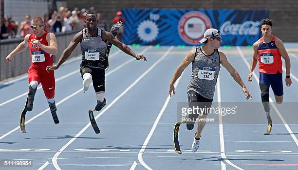Jarryd Wallace turns away from Blake Leeper who lost his blade and crashed into AJ Digby as they all cross the finish line in the Men's 100 Meter...