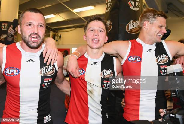 Jarryn Geary Jack Billings and Nick Riewoldt of the Saints sing the song after winning the round seven AFL match between the St Kilda Saints and the...