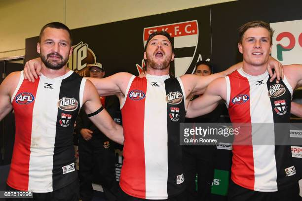 Jarryn Geary Jack Steven and Jack Newnes of the Saints sing the song in the rooms after winning the round eight AFL match between the St Kilda Saints...