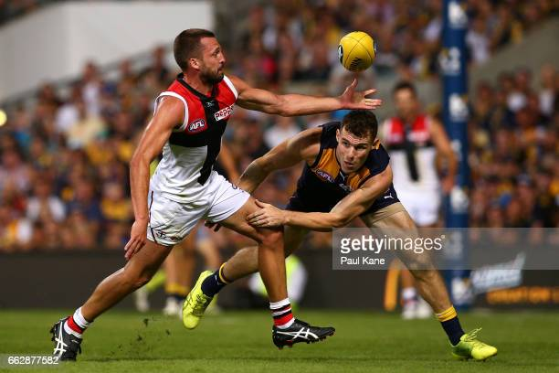 Jarryn Geary of the Saints and Luke Shuey of the Eagles contest for the ball during the round two AFL match between the West Coast Eagles and the St...