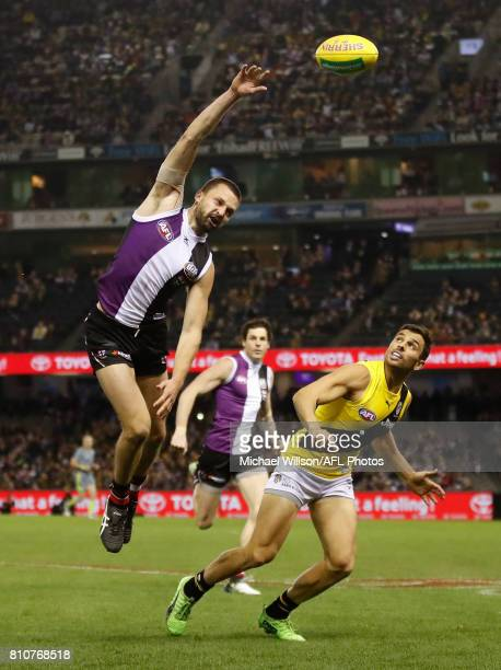 Jarryn Geary of the Saints and Sam Lloyd of the Tigers compete for the ball during the 2017 AFL round 16 match between the St Kilda Saints and the...