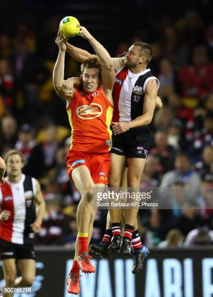 Jarryn Geary of the Saints and Tom Lynch of the Suns compete for the ball during the round 14 AFL match between the St Kilda Saints and the Gold...