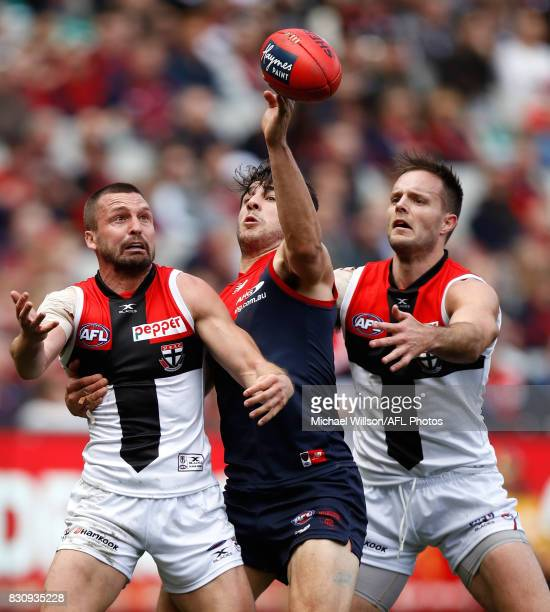 Jarryn Geary of the Saints Christian Petracca of the Demons and Nathan Brown of the Saints compete for the ball during the 2017 AFL round 21 match...