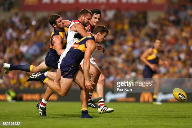 Jarryn Geary of the Saints contests for the ball against Jack Darling and Jamie Cripps of the Eagles during the round two AFL match between the West...