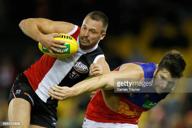 Jarryn Geary of the Saints gathers the ball during the round three AFL match between the St Kilda Saints and the Brisbane Lions at Etihad Stadium on...