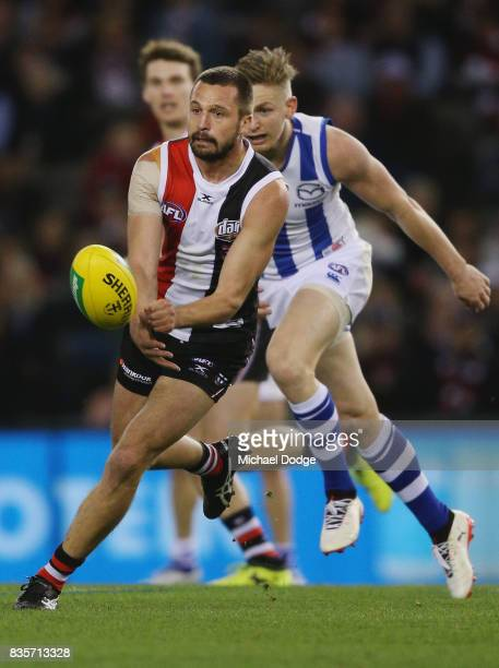 Jarryn Geary of the Saints handballs during the round 22 AFL match between the St Kilda Saints and the North Melbourne Kangaroos at Etihad Stadium on...