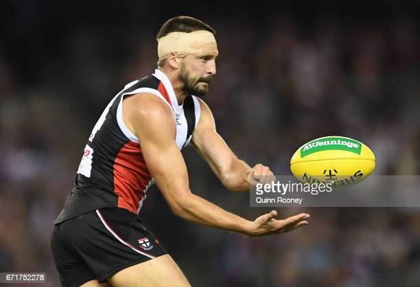 Jarryn Geary of the Saints handballs during the round five AFL match between the St Kilda Saints and the Geelong Cats at Etihad Stadium on April 23...