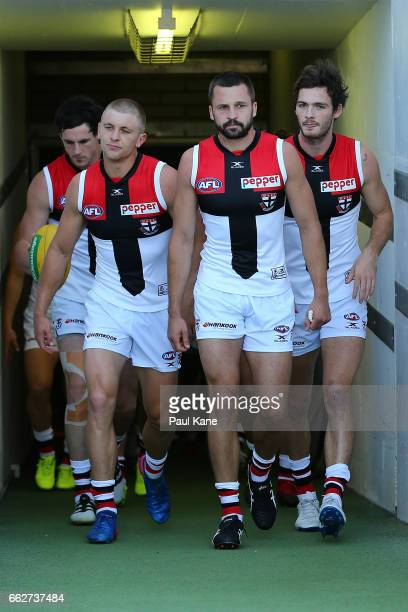 Jarryn Geary of the Saints leads his team onto the field during the round two AFL match between the West Coast Eagles and the St Kilda Saints at...