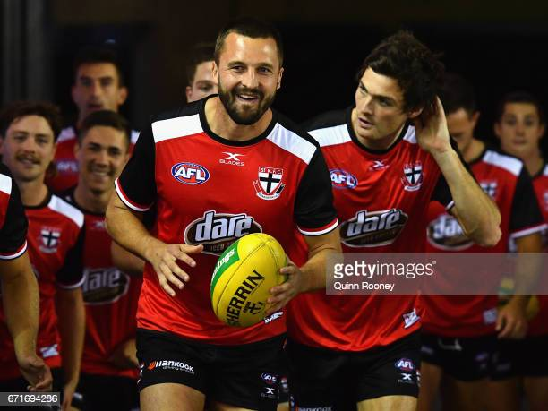 Jarryn Geary of the Saints leads his team out for warm up during the round five AFL match between the St Kilda Saints and the Geelong Cats at Etihad...