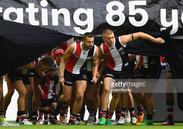 Jarryn Geary of the Saints leads his team through the banner during the round eight AFL match between the St Kilda Saints and the Carlton Blues at...