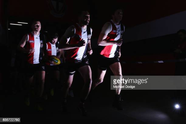 Jarryn Geary of the Saints leads the team out during the round 22 AFL match between the St Kilda Saints and the North Melbourne Kangaroos at Etihad...