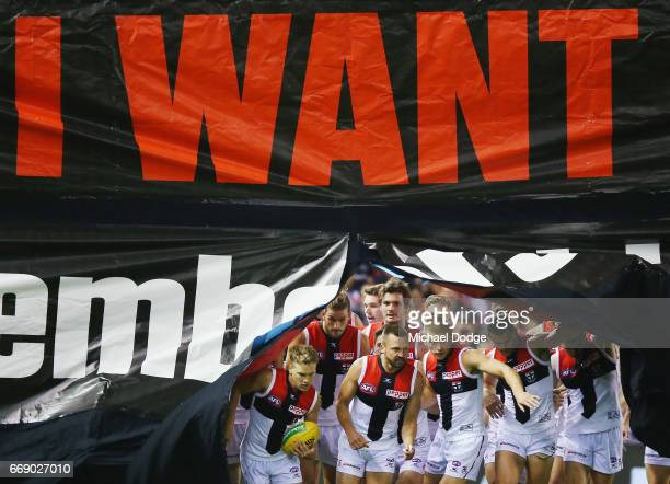 Jarryn Geary of the Saints leads the team out during the round four AFL match between the Collingwood Magpies and the St Kilda Saints at Etihad...