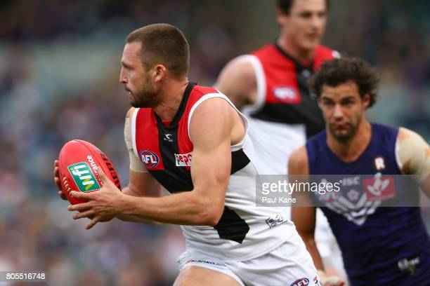 Jarryn Geary of the Saints looks to handball during the round 15 AFL match between the Fremantle Dockers and the St Kilda Saints at Domain Stadium on...
