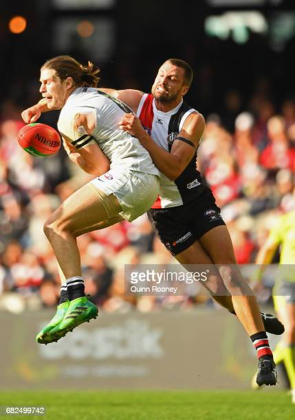 Jarryn Geary of the Saints spoils a mark by Bryce Gibbs of the Blues during the round eight AFL match between the St Kilda Saints and the Carlton...