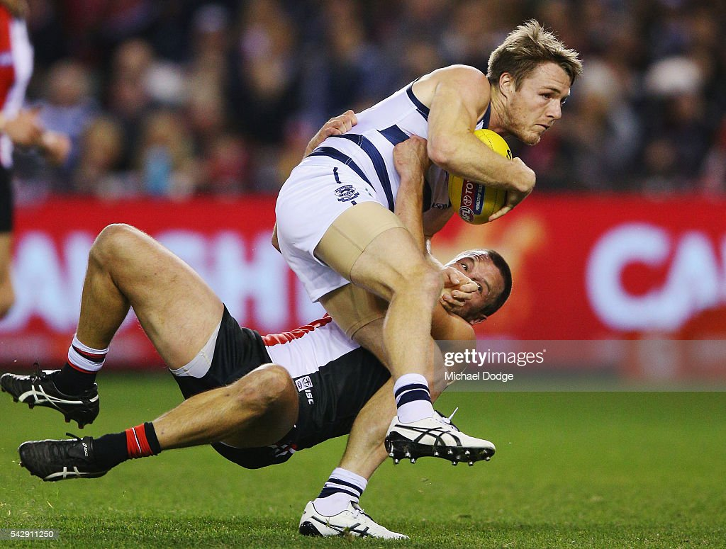 Jarryn Geary of the Saints tackles Lincoln McCarthy of the Cats during the round 14 AFL match between the St Kilda Saints and the Geelong Cats at Etihad Stadium on June 25, 2016 in Melbourne, Australia.