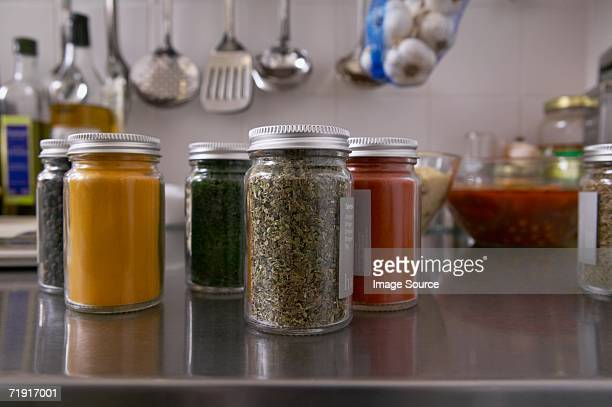Jars filled with herbs and spices in kitchen