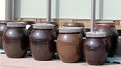 Jars holding Korean traditional sauces.