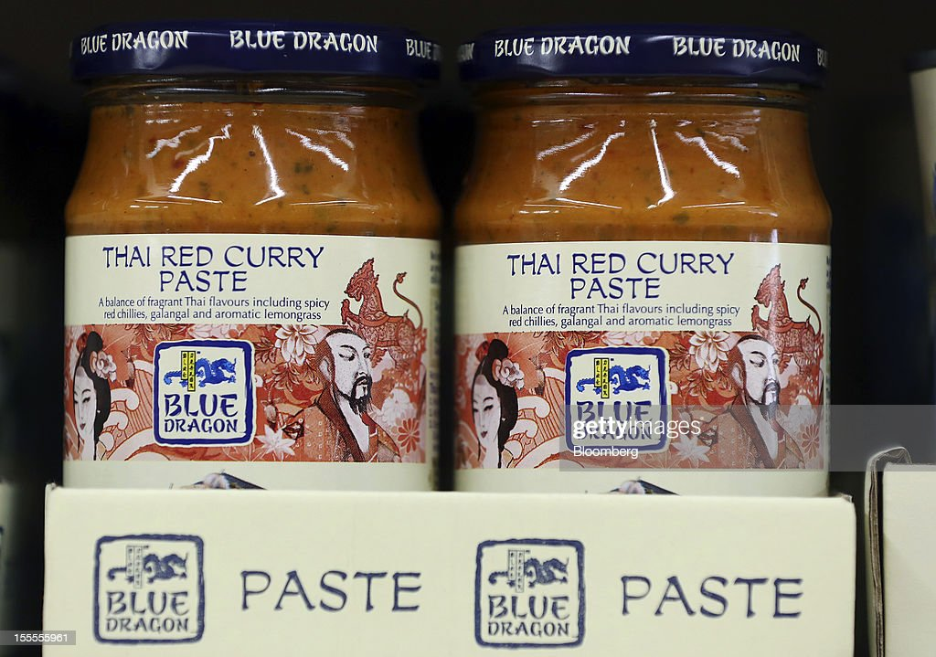 Jars of Blue Dragon Thai red curry paste, produced by Associated British Foods Plc, are displayed for sale on a shelf inside a supermarket in London, U.K., on Monday, Nov. 5, 2012. AB Foods shares have gained 17 percent this year, fueled by the growth of the sugar unit and Primark, the company's two main profit contributors. Photographer: Simon Dawson/Bloomberg via Getty Images