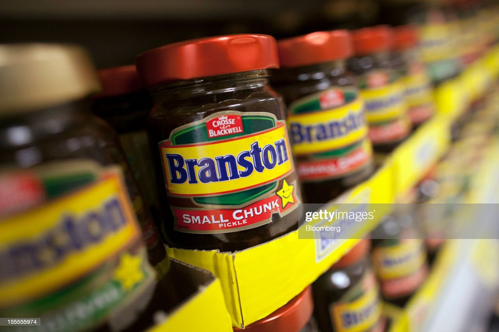 Jars of Branston Pickle, produced by Premier Foods Plc, are displayed for sale at a supermarket in London, U.K., on Monday, Nov. 5, 2012. Premier Foods Plc, the owner of the Hovis bread and Bisto gravy brands said it completed the sale of its vinegar and sour pickles marques, which include the Branston brand, to Mizkan Co. Photographer: Simon Dawson/Bloomberg via Getty Images