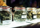 A dispensary worker vending jars of cannabis.