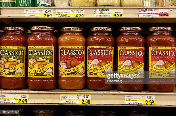 Jars of Classico pasta sauce made by HJ Heinz Co are displayed on a shelf for sale at grocery store in Pittsburgh Pennsylvania US on Thursday Feb 14...