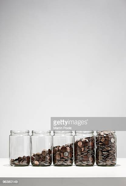jars of coins showing growth