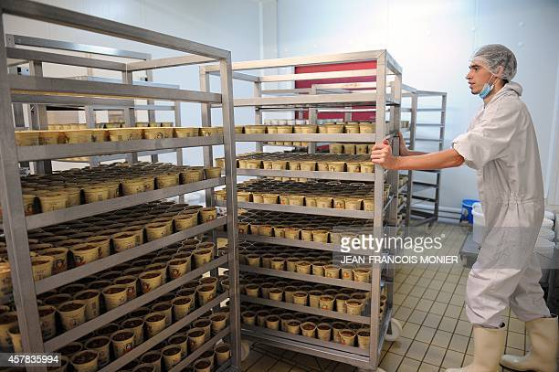 Jars of freshly prepared 'rillettes' a meat preparation similar to pate are loaded onto carts to be chilled at the Charcuterie Cosme in Le Mans...