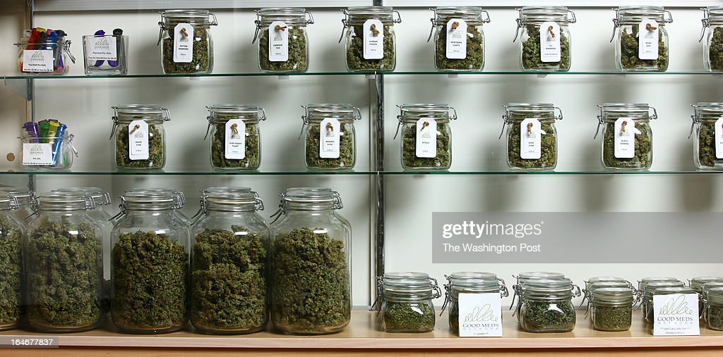 Jars of medical cannabis line the shelves inside a Good Meds medical cannabis center in Lakewood, Colorado, U.S., on Monday, March 4, 2013. This is at a Good Meds medical cannabis center in Lakewood, and is one of the facilities that Kristi Kelly, Co-Founder of Good Meds Network, operates.