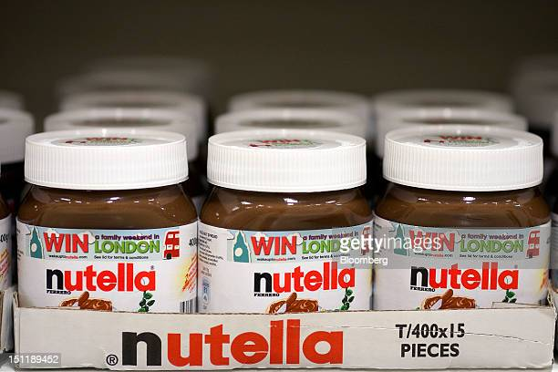 Jars of nutella hazelnut chocolate spread manufactured by Ferrero SpA sit in boxes on a shelf inside a supermarket in Slough UK on Monday Sept 3 2012...