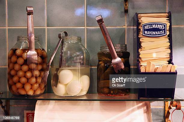 Jars of pickled onions picked eggs and gherkins are on sale to accompany traditional fish and chips in Olley's fish restaurant on February 22 2011 in...