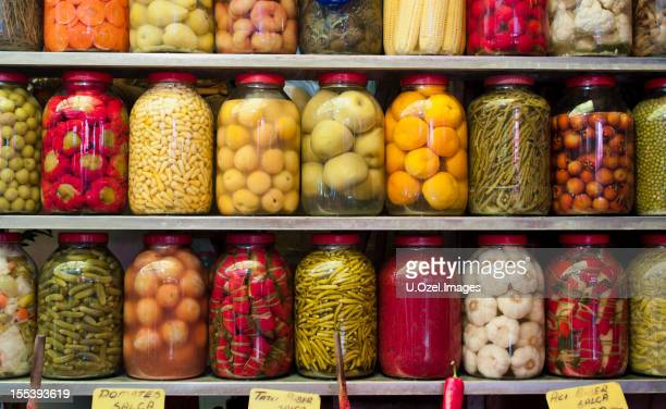 Jars of preserved vegetables on shelves
