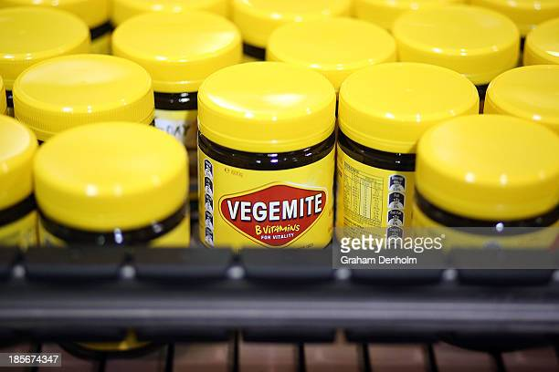 Jars of Vegemite are seen on the production line during a press call to celebrate the Vegemite brand's 90th year at the Vegemite factory on October...