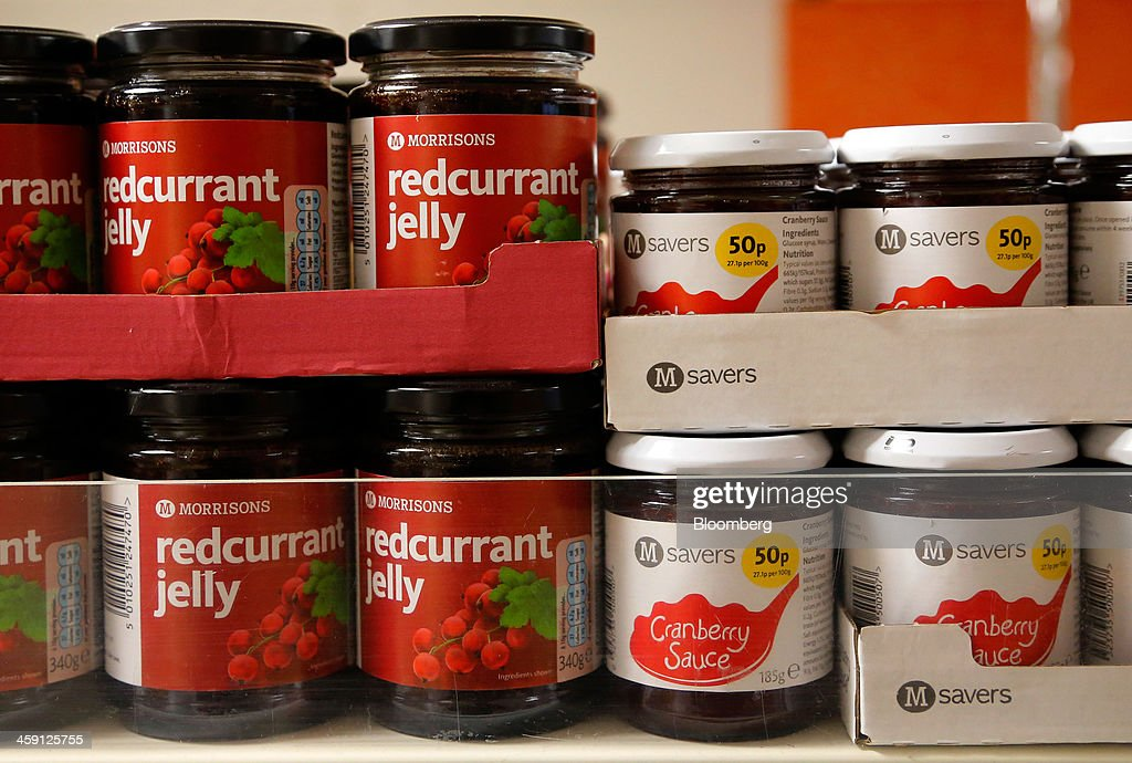 Jars of William Morrison Supermarkets Plc own brand redcurrant jelly and cranberry sauce sit for sale inside the Community shop, a supermarket for low-income families, in Goldthorpe, U.K., on Monday, Dec. 23, 2013. Company Shop Ltd. created the Community shop for people in, or bordering on, food poverty, selling surplus goods from major retailers at discounted prices. Photographer: Paul Thomas/Bloomberg via Getty Images