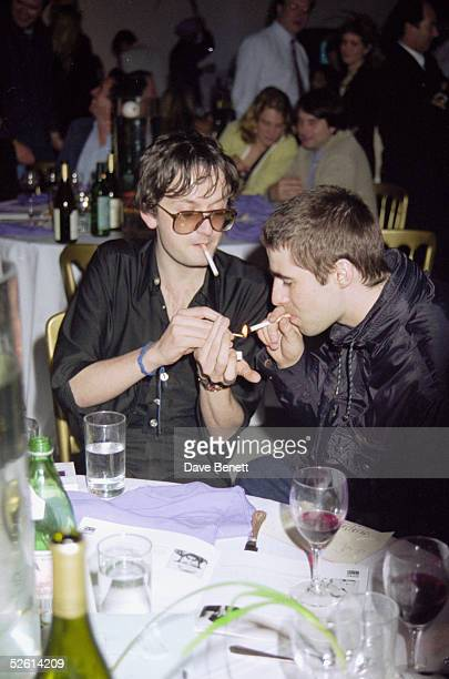 Jarvis Cocker and Liam Gallagher attend a gala fundraising dinner for War Child at the Saatchi Gallery London 4th February 1997 Artworks by famous...