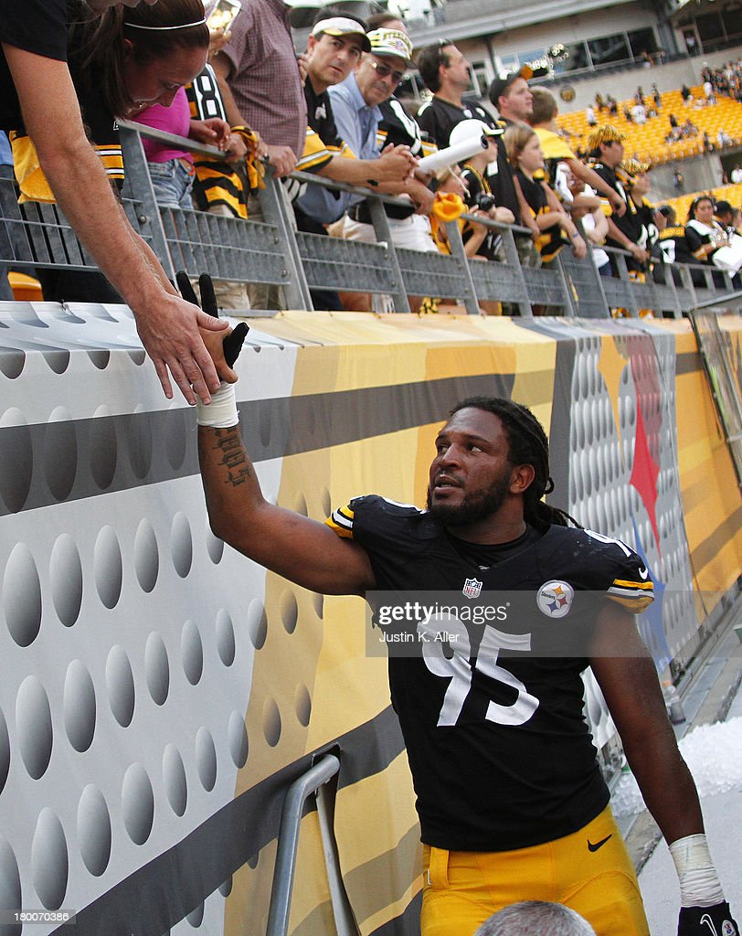 <a gi-track='captionPersonalityLinkClicked' href=/galleries/search?phrase=Jarvis+Jones&family=editorial&specificpeople=6236463 ng-click='$event.stopPropagation()'>Jarvis Jones</a> #95 of the Pittsburgh Steelers gives high fives to fans after the game against the Tennessee Titans on September 8, 2013 at Heinz Field in Pittsburgh, Pennsylvania. The Titans defeated the Steelers 16-9.