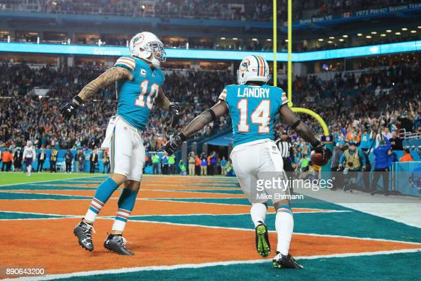 Jarvis Landry celebrates with Kenny Stills of the Miami Dolphins after scoring a touchdown in the second quarter against the New England Patriots at...