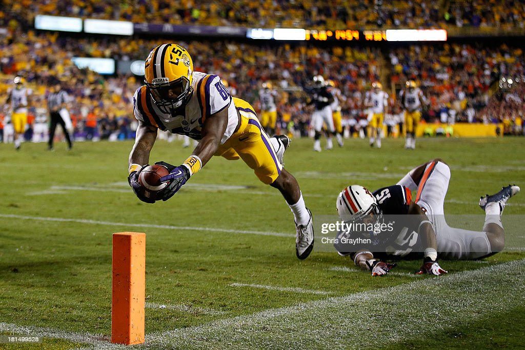 Jarvis Landry #80 of the LSU Tigers dives for a touchdown after avoiding a tackle by Joshua Holsey #15 of the Auburn Tigers at Tiger Stadium on September 21, 2013 in Baton Rouge, Louisiana.
