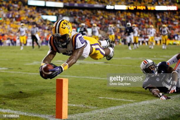 Jarvis Landry of the LSU Tigers dives for a touchdown after avoiding a tackle by Joshua Holsey of the Auburn Tigers at Tiger Stadium on September 21...