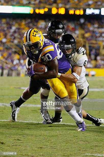Jarvis Landry of the LSU Tigers is tackled Aaron Grymes and Gary Walker of the Idaho Vandals at Tiger Stadium on September 15 2012 in Baton Rouge...